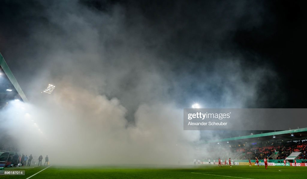 Fans of Eintracht Frankfurt burn flares / firework during the DFB Cup match between 1. FC Heidenheim and Eintracht Frankfurt at Voith-Arena on December 20, 2017 in Heidenheim, Germany.