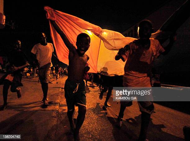 Fans of Elephants of Ivory Coast parade in the streets of Abidjan on February 4 2012 as they celebrate the qualification of their team in the...