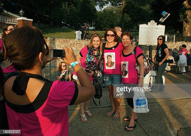 Fans of Elvis Presley gather outside Graceland mansion home of the late king of rock'n'roll on August 15 the eve of the 35th anniversary of his death...
