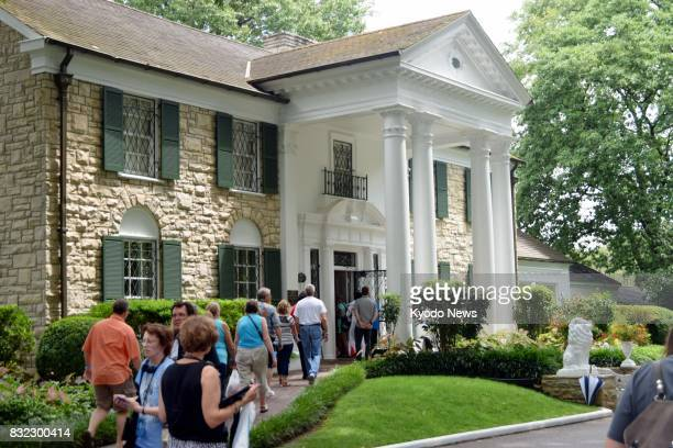 Fans of Elvis Presley the king of rock and roll visit his Graceland Mansion in Memphis Tennessee on Aug 15 a day before the 40th anniversary of his...
