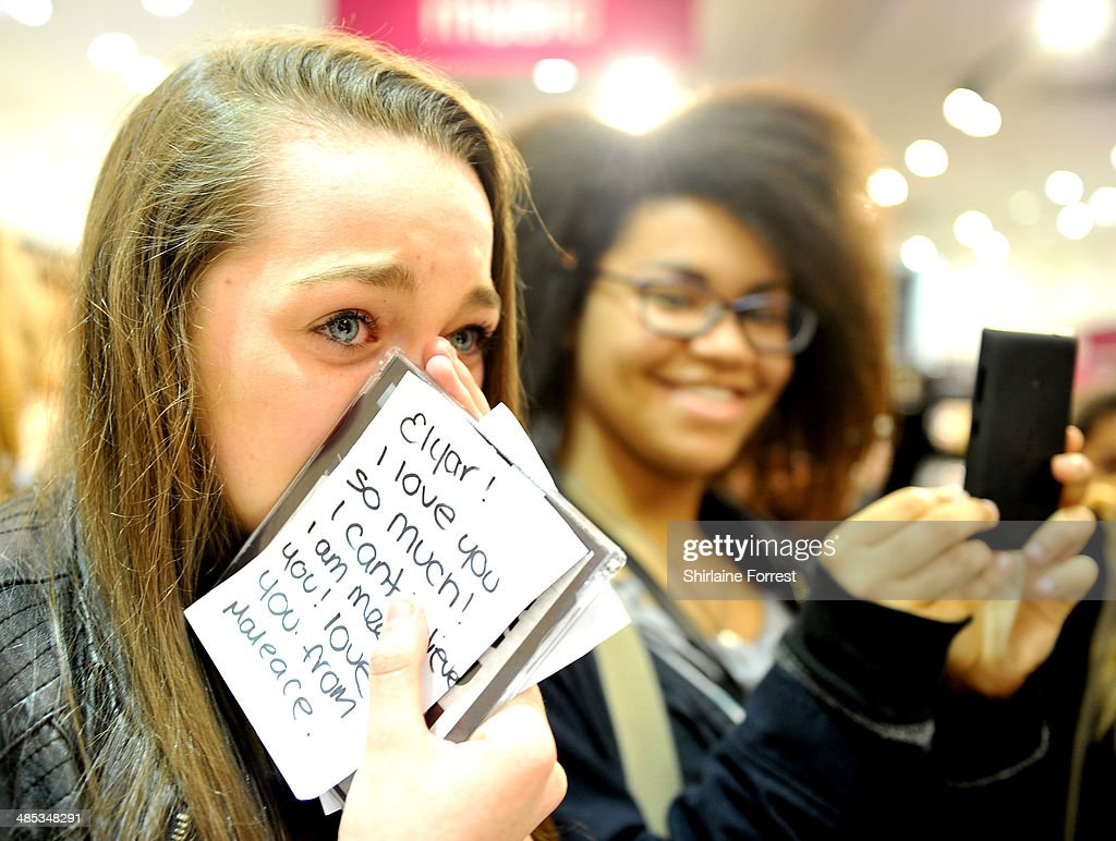 Fans of Elyar Fox await the artist performing and signing copies of his new single 'A Billion Girls' at HMV Manchester on April 17, 2014 in Manchester, England.