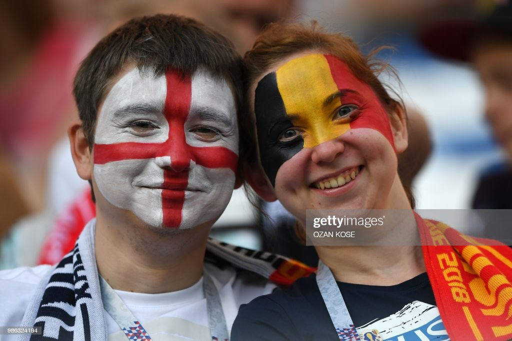 TOPSHOT - Fans of England and Belgium pose before the Russia 2018 World Cup Group G football match between England and Belgium at the Kaliningrad Stadium in Kaliningrad on June 28, 2018. (Photo by OZAN KOSE / AFP) / RESTRICTED