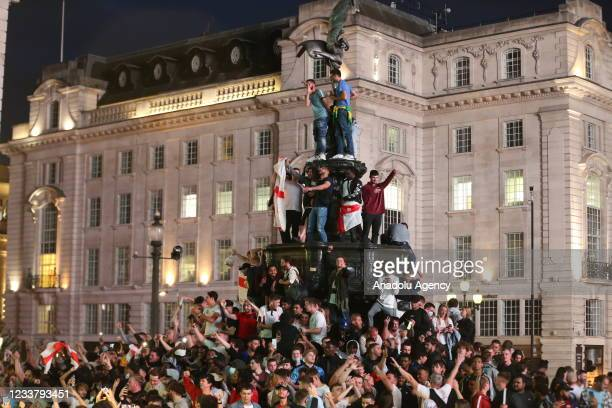 Fans of England celebrate after winning the UEFA EURO 2020 quarterfinal football match between Ukraine with 4-0, on July 3, 2021 in London, United...