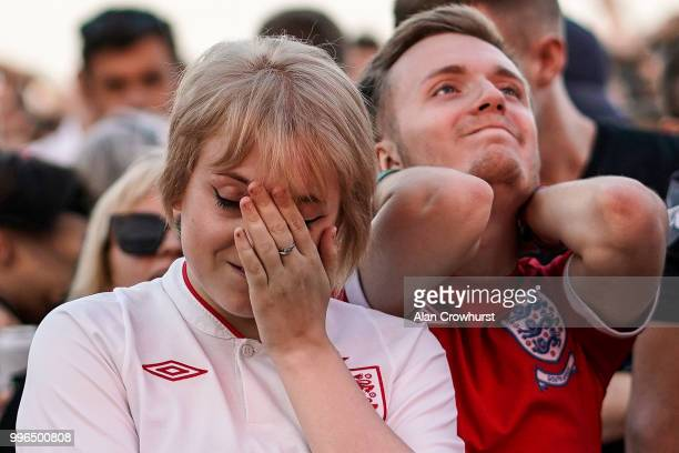 Fans of England look dejected during the 2018 FIFA World Cup semi final match between Croatia and England at the Luna Beach Cinema on Brighton Beach...