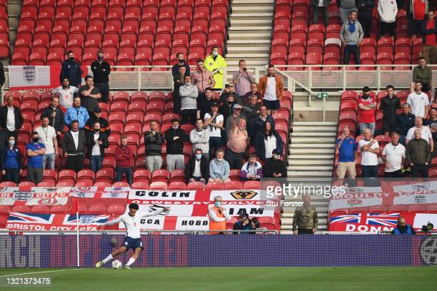Fans of England look on as Trent Alexander-Arnold of England takes a corner during the international friendly match between England and Austria at...