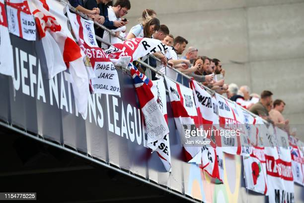 Fans of England show their support ahead of the UEFA Nations League Third Place Playoff match between Switzerland and England at Estadio D Afonso...