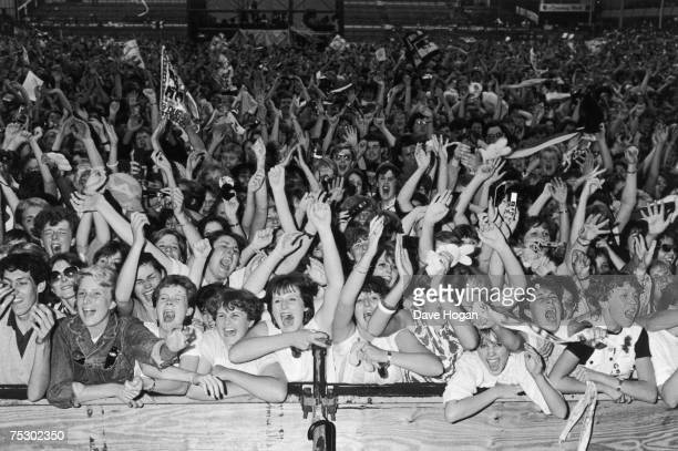 Fans of English new romantic pop group Duran Duran at one of the band's concerts 1984