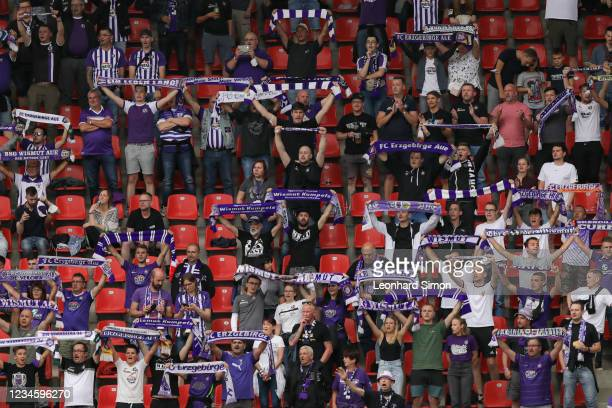 Fans of Erzgebirge Aue during the DFB Cup first round match between FC Ingolstadt 04 and Erzgebirge Aue at Audi Sportpark on August 9, 2021 in...