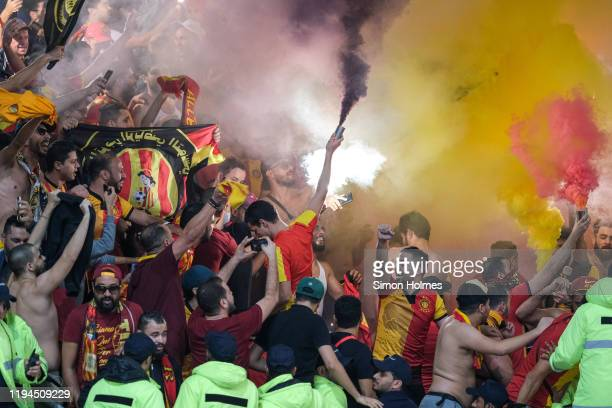 Fans of Esperance Sportive de Tunis set off flares during the FIFA Club World Cup match between AL Sadd and Esperance Sportive de Tunis at Khalifa...