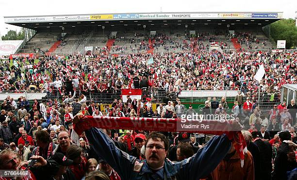 Fans of Essen celebrate after the end of the Third League match between Rot Weiss Essen and Werder Bremen II at the GeorgMelches Stadium on May 18...