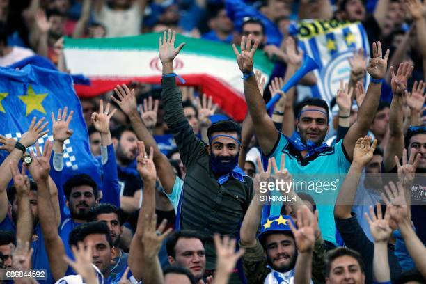 Fans of Esteghlal cheer during the 2017 AFC Champions League round 16 football match between Iran's Esteghlal FC and UAE's AlAin FC at the Azadi...