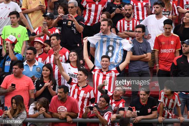 Fans of Estudiantes cheer during the presentation of Javier Mascherano as new player of Estudiantes de La Plata at Jorge Luis Hirschi Stadium on...