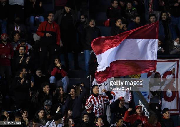 Fans of Estudiantes de La Plata cheer for their team during a round of sixteen first leg match between Estudiantes de La Plata and Gremio as part of...