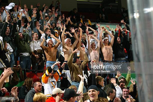 Fans of Evgeni Malkin of the Pittsburgh Penguins stand and cheer during the game against the New Jersey Devils on October 24 2006 at the Mellon Arena...