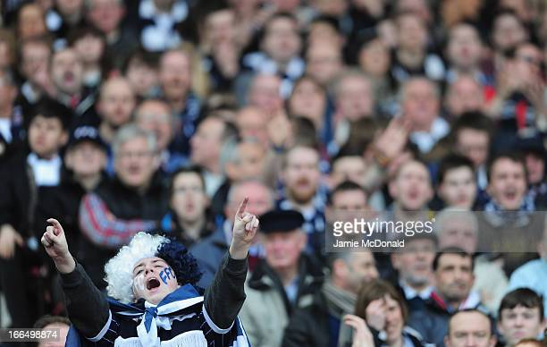 Fans of Falkirk show there colours during The William Hill Scottish Cup Semi Final between Falkirk and Hibernian at Hampden Park on April 13 2013 in...