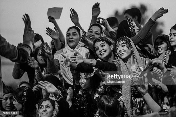 Fans of Farhad Darya an Afghan singer at a concert in MazariSharif Afghanistan This specific concert is only for female fans During Taliban rule...