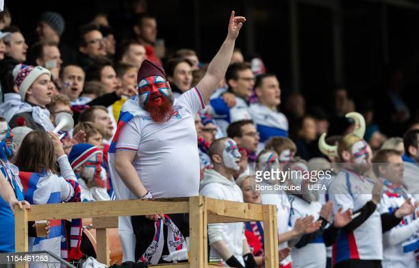 Fans of Faroe Islands celebrate during the UEFA Euro 2020 Qualifier Group F match between Faroe Islands and Spain at Torsvollur on June 07, 2019 in...