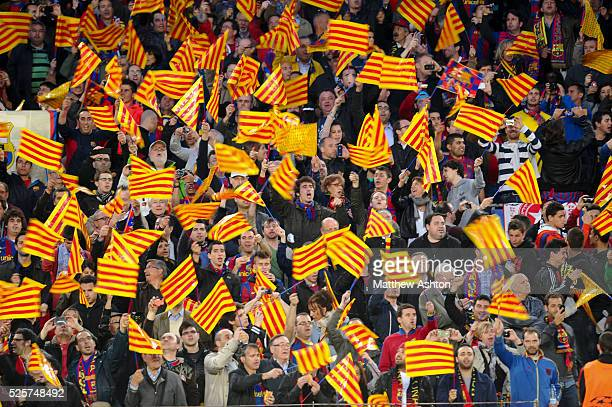 Fans of FC Barcelona wave Catalan flags
