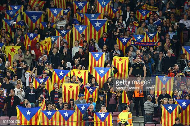 Fans of FC Barcelona wave Esteladas to protest against UEFA who have twice fined The FC Barcelona for letting fans fly the flag at matches during the...