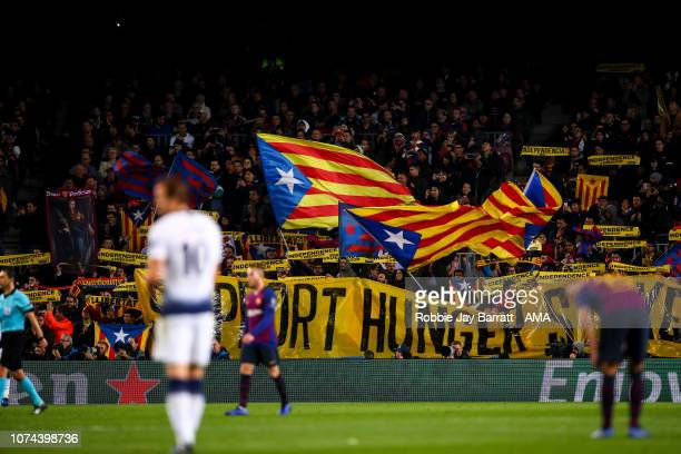 Fans of FC Barcelona wave flags and banners in protest of the independence of Catalonia during the UEFA Champions League Group B match between FC...