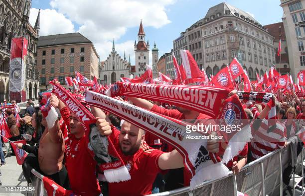 Fans of FC Bayern Muenchen celebrate waiting for the FC Bayern Muenchen team to celebrate the Bundesliga title and the German Cup title for the...