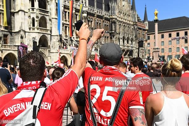 Fans of FC Bayern Muenchen celebrate winning the German Championship and the DFB Cup 2016 on the town hall balcony at Marienplatz on May 22 2016 in...