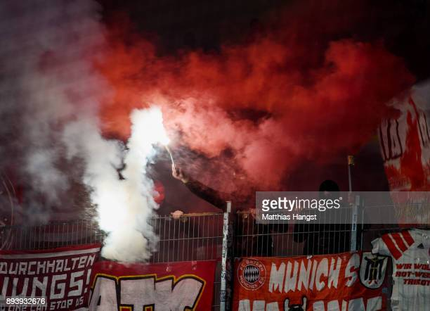 Fans of FC Bayern Muenchen set off pyro flares during the Bundesliga match between VfB Stuttgart and FC Bayern Muenchen at MercedesBenz Arena on...
