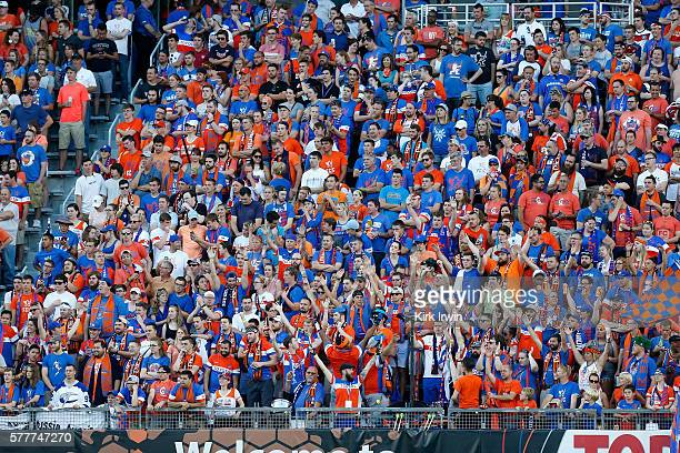 Fans of FC Cincinnati cheer on their team during the match against Crystal Palace FC at Nippert Stadium on July 16 2016 in Cincinnati Ohio