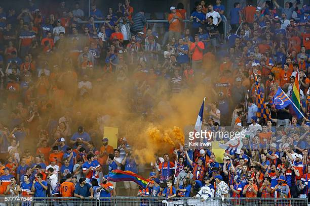 Fans of FC Cincinnati set off smoke bombs while cheering on their team during the match against Crystal Palace FC at Nippert Stadium on July 16 2016...