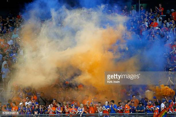 Fans of FC Cincinnati set up smoke bombs in support of their team after the conclusion of the match against Crystal Palace FC at Nippert Stadium on...
