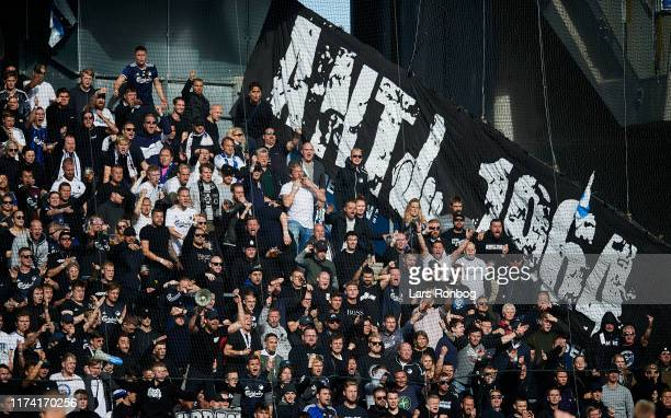 Fans of FC Copenhagen cheer with an Anti 1964 tifo during the Danish 3F Superliga match between Brondby IF and FC Copenhagen at Brondby Stadion on...