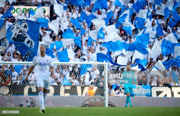 Fans of FC Copenhagen cheer with flags during the Danish Alka Superliga Europa League Playoff match between FC Copenhagen and AGF Aarhus at Telia...