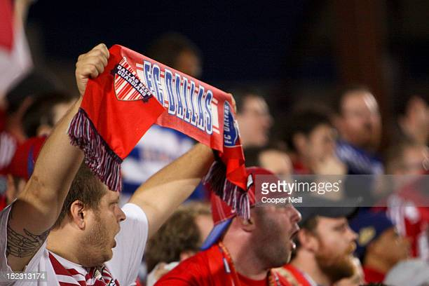Fans of FC Dallas cheer as their team faces off against the Vancouver Whitecaps FC on September 15 2012 at FC Dallas Stadium in Frisco Texas