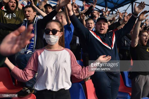Fans of FC DinamoMinsk support their team during the Belarus Championship football match between FC Minsk and FC DinamoMinsk in Minsk on March 28...