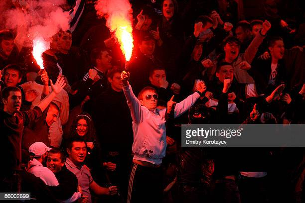 Fans of FC Dynamo Kiev react during the UEFA Cup Quarter finals second leg match between Dynamo Kiev and Paris SaintGermain FC at the Valeri...