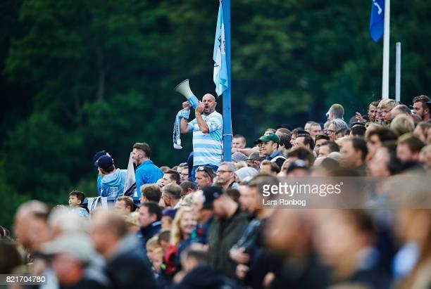 Fans of FC Helsingor cheer during the Danish Alka Superliga match between FC Helsingor and OB Odense at Helsingor Stadion on July 24 2017 in...