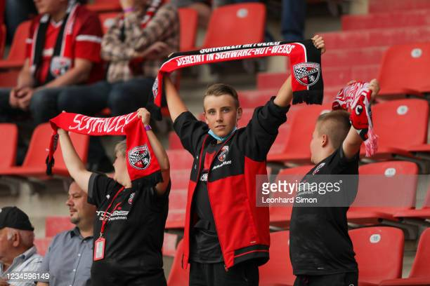 Fans of FC Ingolstadt 04 during the DFB Cup first round match between FC Ingolstadt 04 and Erzgebirge Aue at Audi Sportpark on August 9, 2021 in...