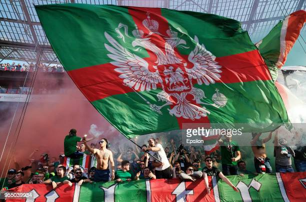 Fans of FC Lokomotiv Moscow react during the Russian Football League match between FC Lokomotiv Moscow and FC Zenit Saint Petersburg at Lokomotiv...