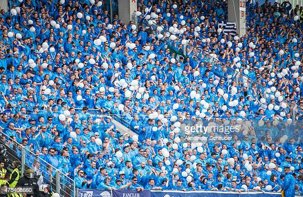 fans of fc magdeburg with balloons during the Regionalliga Playoff match between Kickers Offenbach and 1 FC Magdeburg at SpardaBankHessenStadion on...