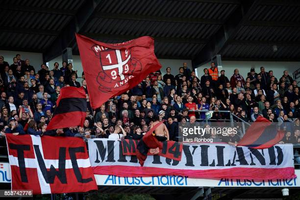 Fans of FC Midtjylland cheer during the Danish Alka Superliga match between AGF Aarhus and FC Midtjylland at Ceres Park on September 25 2017 in...
