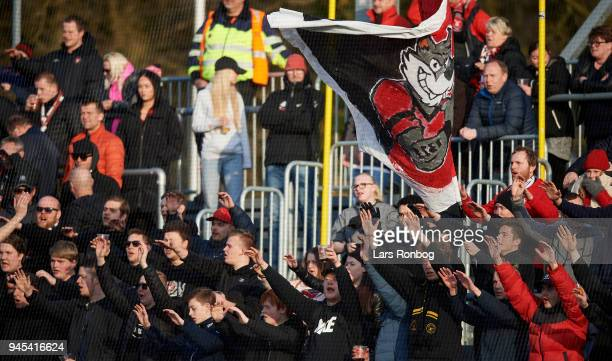 Fans of FC Midtjylland cheer during the Danish DBU Pokalen Cup quarterfinal match between Hobro IK and FC Midtjylland at DS Arena on April 12 2018 in...