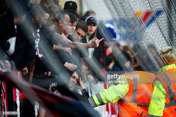 Fans of FC Midtjylland gestures at the stewards during the Danish Alka Superliga match between Viborg FF and FC Midtjylland at Energi Viborg Arena on...
