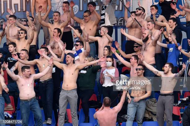 Fans of FC Minsk support their team during the Belarus Championship foolball match between FC Minsk and FC DinamoMinsk in Minsk on March 28 2020 In...