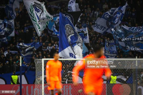 Fans of FC Porto wave flags and banners during the UEFA Champions League Round of 16 First Leg match between FC Porto and Liverpool at Estadio do...