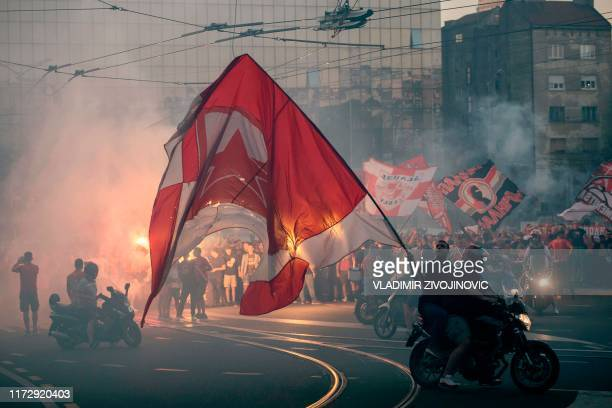 Fans of FC Red Star Belgrade and FC Olympiacos walk through the Belgrade prior to the the UEFA Champions League Group B football match between Red...