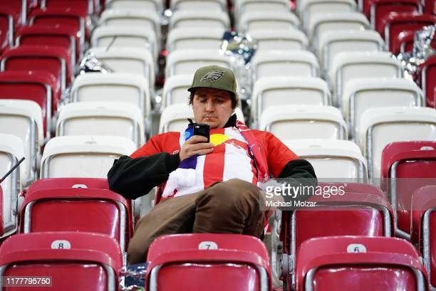 Fans of FC Salzburg react after their teams loss during the Group E UEFA Champions League match between Red Bull Salzburg and SSC Napoli at Red Bull...
