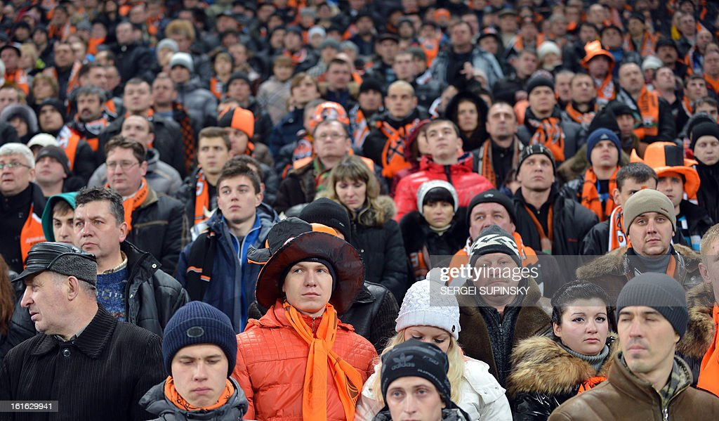 Fans of FC Shakhtar stand to pay tribute to football fans who were on board of an Antonov AN-24 plane which made an emergency landing in Donetsk on February 13, 2013. Five people died when the Antonov AN-24 plane with dozens of football fans on board made an emergency landing in the eastern Ukraine city of Donetsk, officials said. The cause of the accident was not immediately clear but the plane was flying from the southern resort city of Odessa when it overturned and began breaking up upon landing at Donetsk airport, according to the ministry.