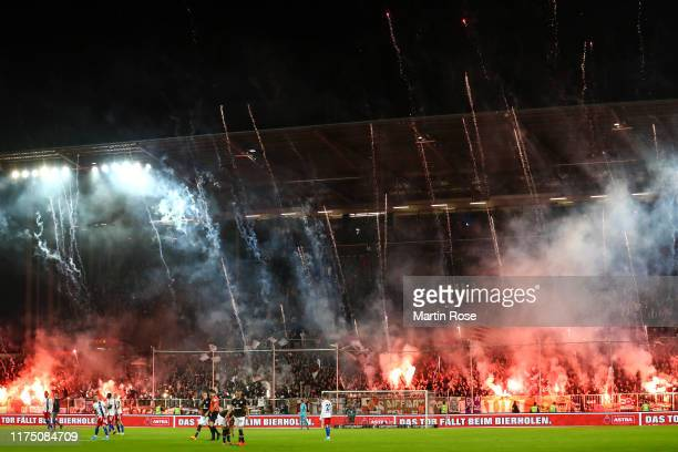 Fans of FC St. Pauli burn fire during the Second Bundesliga match between FC St. Pauli and Hamburger SV at Millerntor Stadium on September 16, 2019...