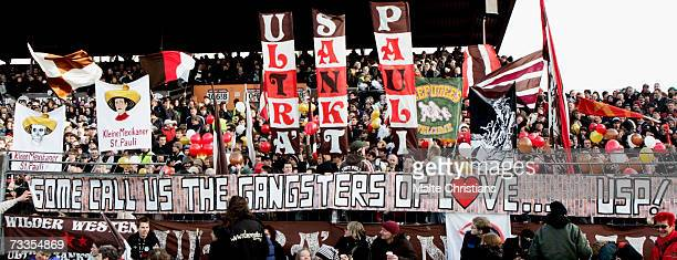 Fans of FC St. Pauli wave banners during the Third League match between FC St.Pauli and VFB Luebeck at the Millerntor stadium on February 17, 2007 in...