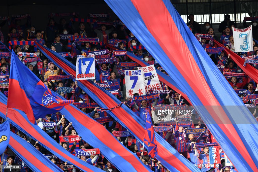 Fans of FC Tokyo cheer prior to the J.League J1 match between FC Tokyo and Vegalta Sendai at Ajinomoto Stadium on March 3, 2018 in Chofu, Tokyo, Japan.